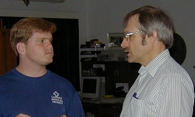 Author (right) in discussion with a colleague